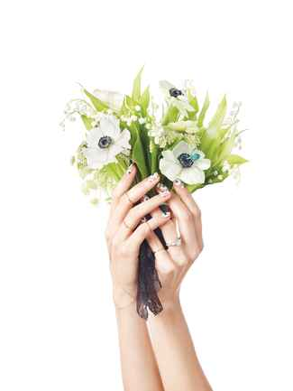 Wedding bouquet with lily of the valley and anemones
