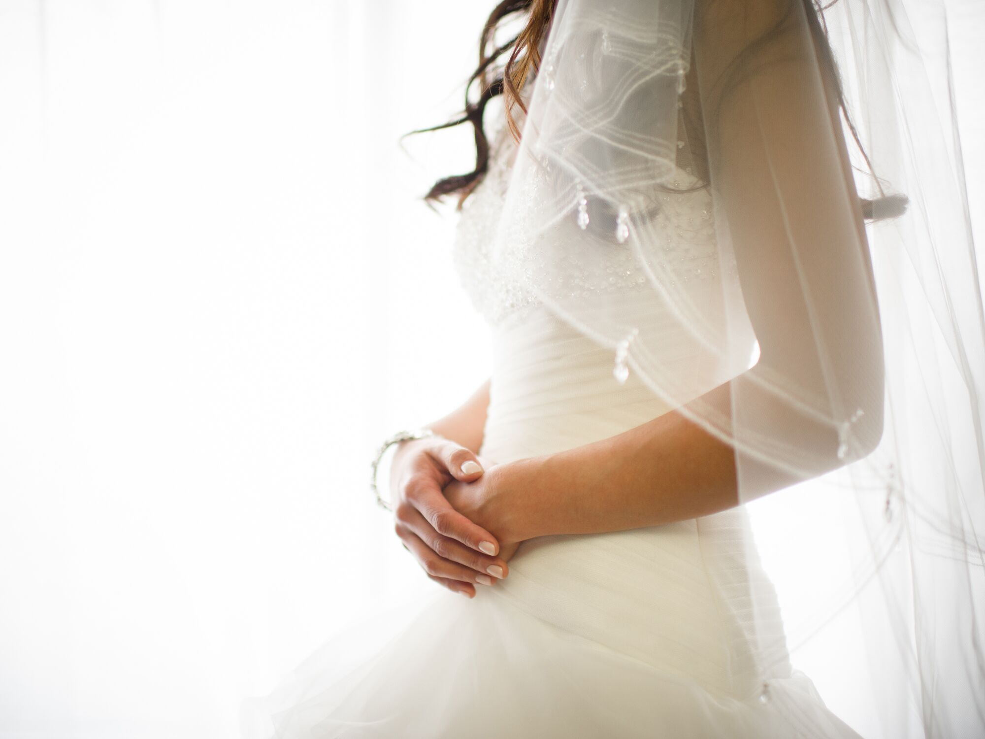 Bride's wedding dress and veil