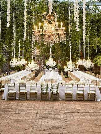 ​Outdoor wedding reception with chandeliers