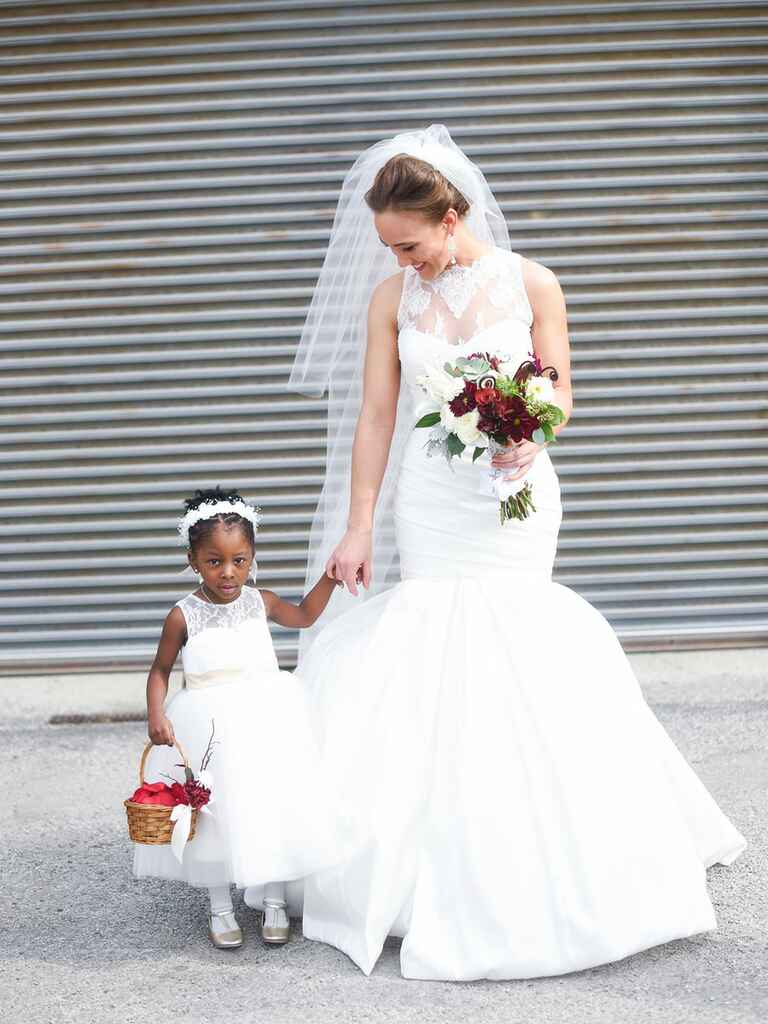 Bride and flower girl in white on wedding day