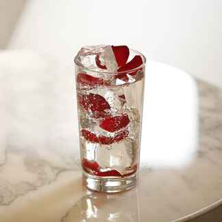 clear sparkling cocktail with berries