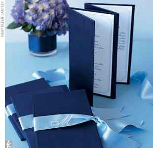 Blue monogrammed wedding programs