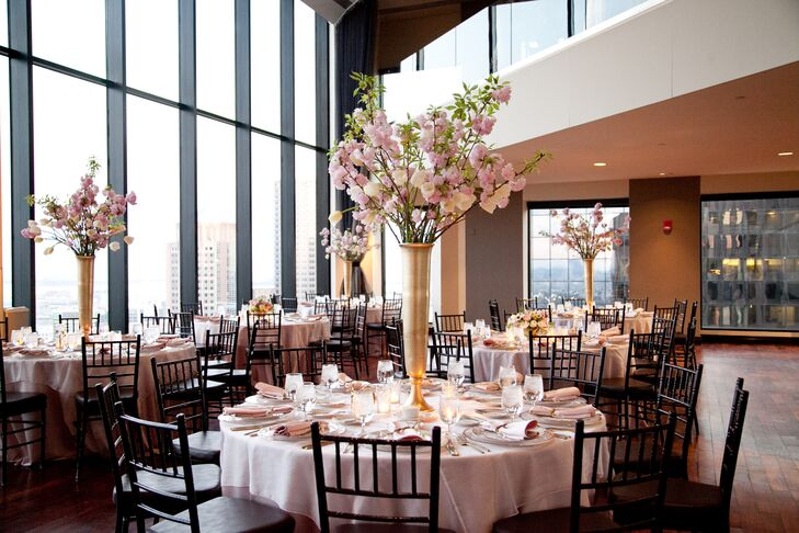 For the tall, statement centerpieces, Petalena Flowers tapped into the spring season for inspiration. Using pale pink French tulips and fresh, fragrant cherry blossoms, the team of florists filled the chic, modern venue with undeniable spring flair.