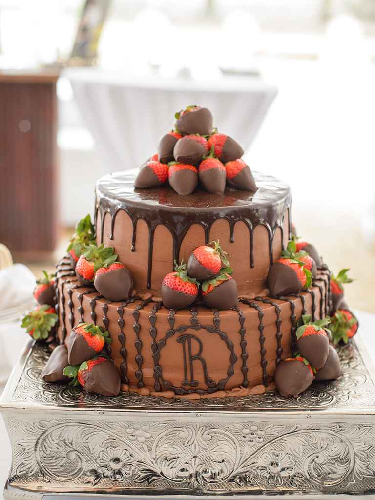 Two-tier chocolate groom's cake with chocolate covered strawberries