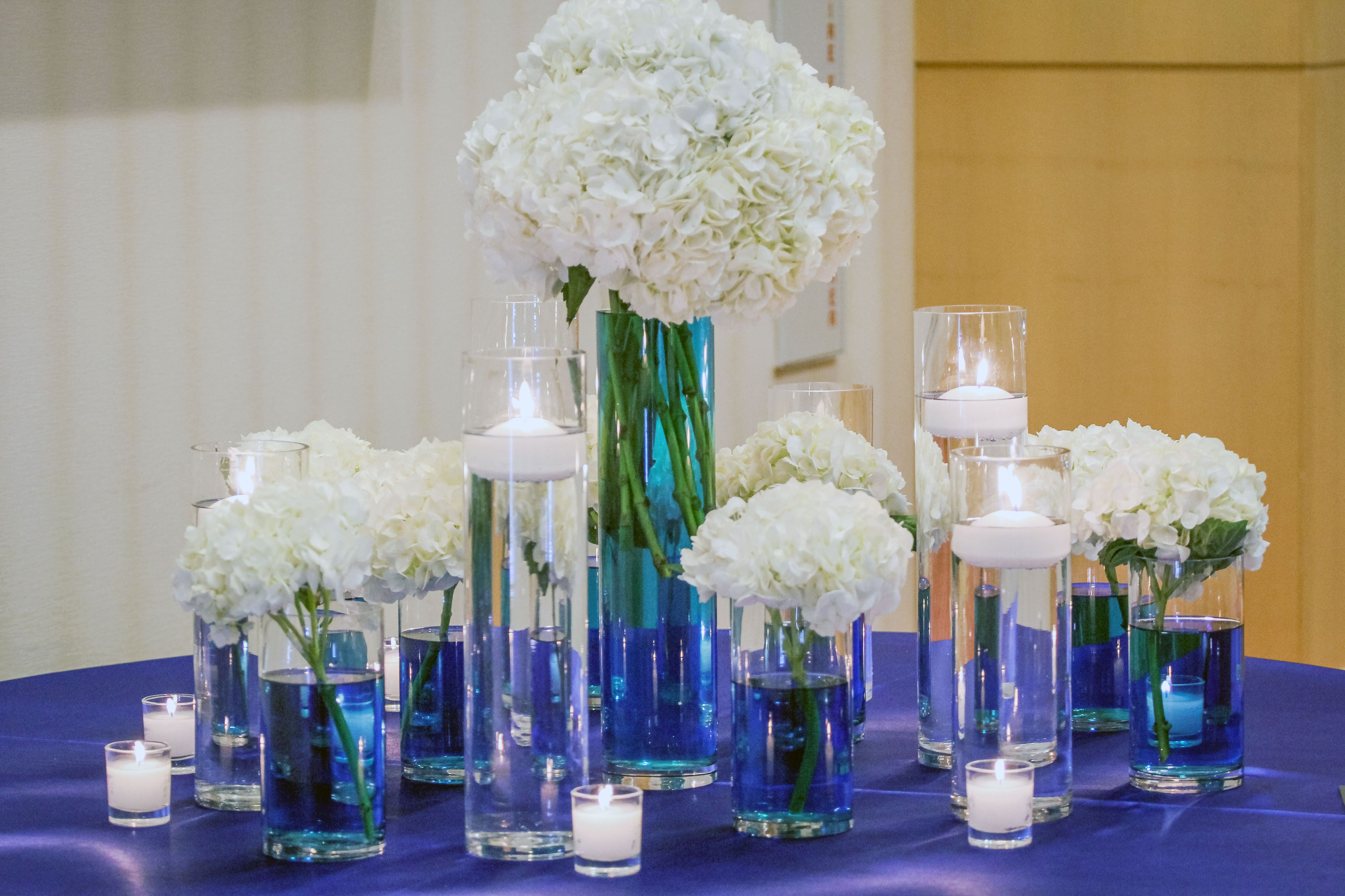 White hydrangea centerpieces with blue water - Blue and white centerpieces ...