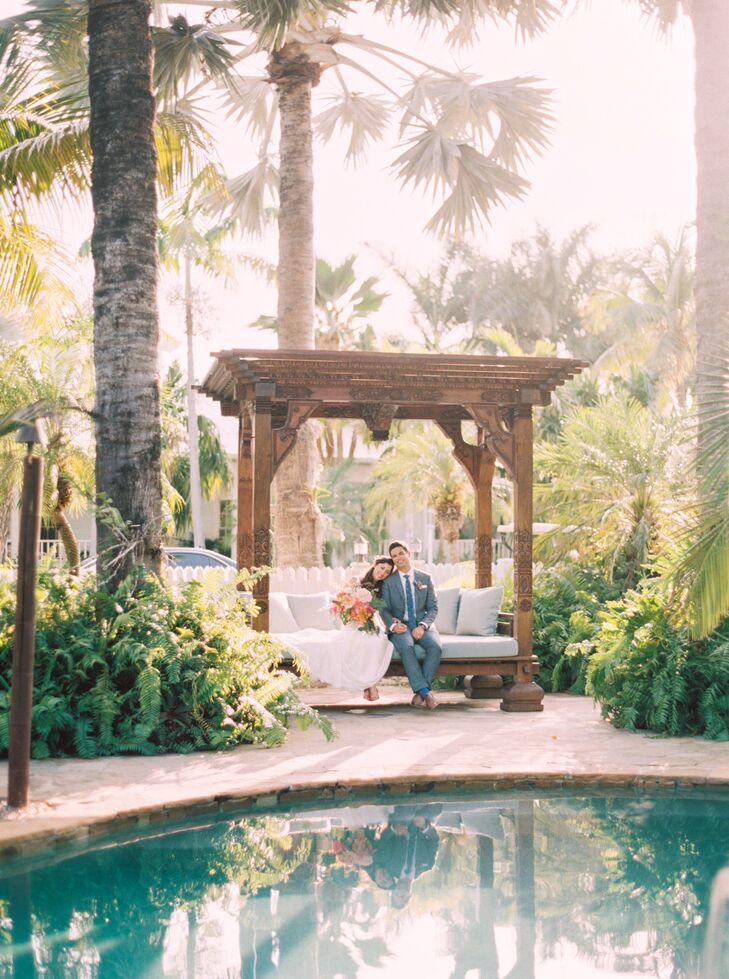 The couple also took some time alone to explore the Caribbean Resort's grounds during their wedding  in Islamorada, Florida. Michelle March, their photographer, snapped away as Francesca and Michael cuddled under an ornate wooden arbor that closely resembled their wedding arch.