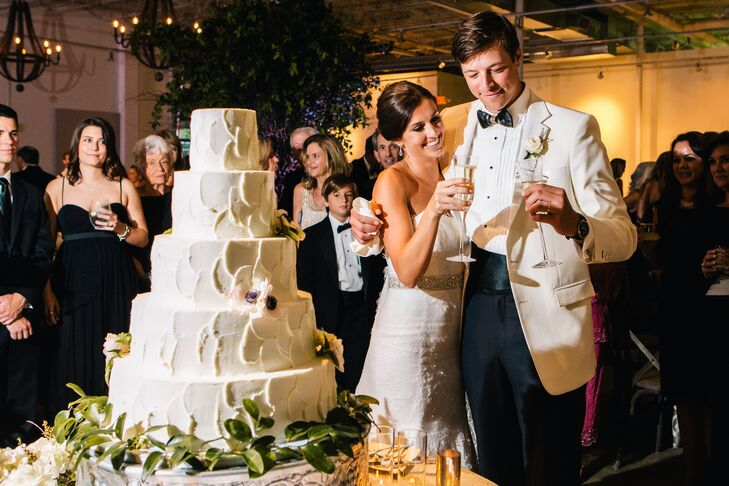Mary Claire and William enjoyed a glass of champagne before cutting into their multi-tiered wedding cake, which featured real flowers as decoration.