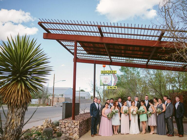 Wedding party standing outside