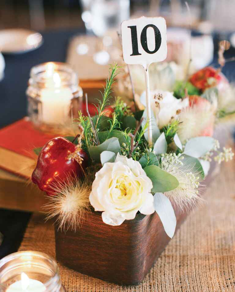 Rustic wooden boxed centerpiece with apples and table number