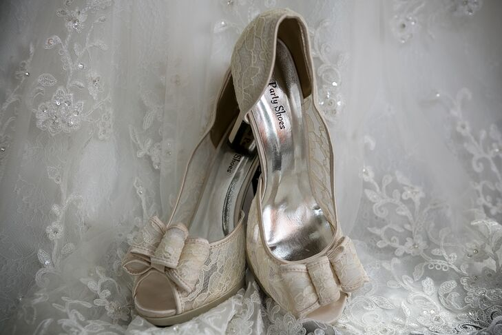 Megan wore champagne colored bridal shoes, with an open-toed style and lace design.