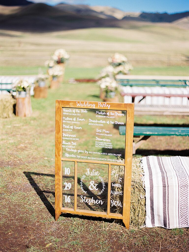 Rustic wedding ceremony sign with the wedding party names
