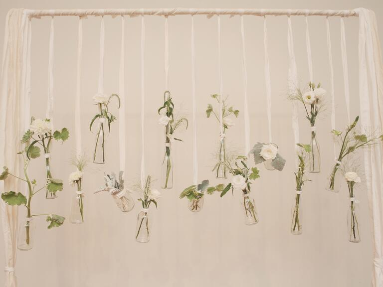 Hanging vase wedding ceremony backdrop