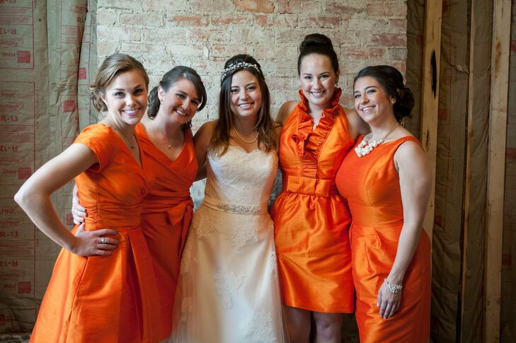 "Diana's bridesmaids wore variations of a knee-length satin dress in a shade of burnt orange—the bride's favorite color. ""They were allowed to pick whatever style of dress they wanted,"" Diana says. ""I think everyone was a little nervous about the loud color, but they all looked gorgeous."""