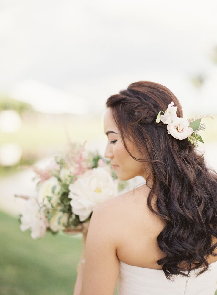 "As she usually does not wear makeup, Joyce opted for a natural look, She wore her hair down and in a curls with a simple braid. ""During the ceremony, we incorporated a few flowers hugging the braid as well,"" says Joyce."