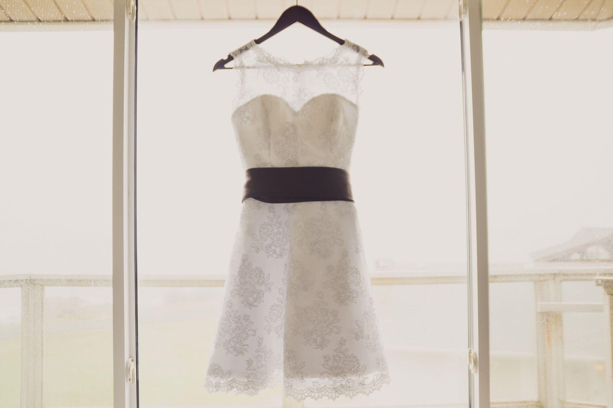 Short White Wedding Dress On Hanger
