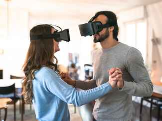 couple wearing virtual reality goggles