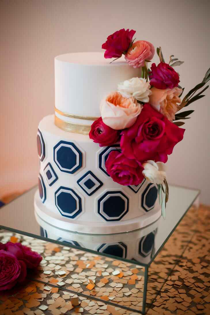 White fondant wedding cake with blue geometric accents