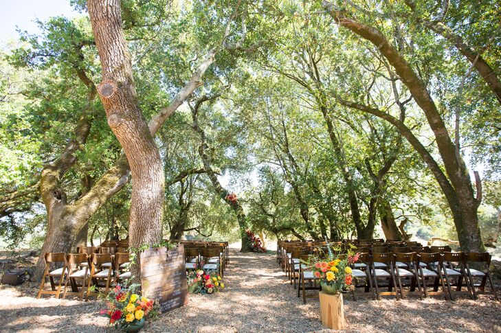 """For the ceremony we chose a forested area under the arches of the trees. We wanted a ceremony site that was not over decorated,"" Karin says. ""We did not want to take away from the ceremony itself or the space itself."""