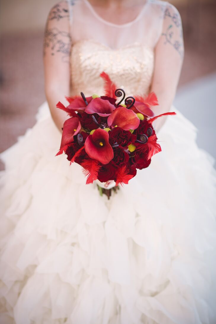 Courtney's bold red bouquet included red calla lilies, roses and pops of yellow craspedia.