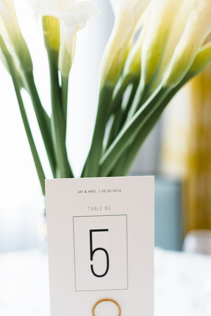 At the reception at the Confidante in Miami Beach, Florida, each table was topped with a simple clean vase of calla lilies and a sleek table number.