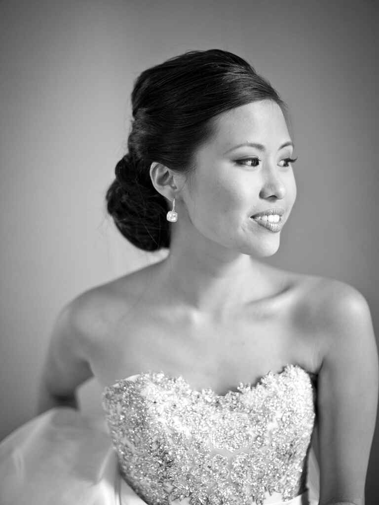 bride wearing a strapless wedding gown with a chignon hairstyle