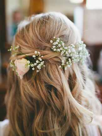Loose half-up wedding hairstyle with baby's breath