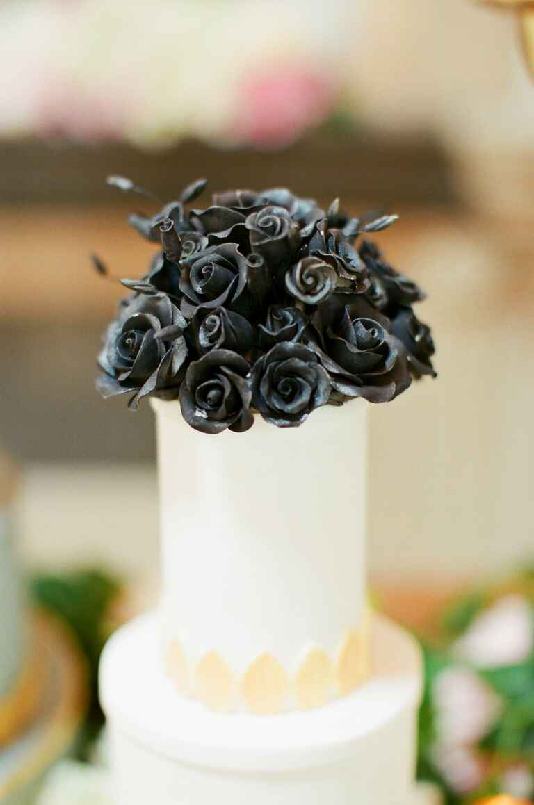 Wedding cake by Made In Heaven cakes with black rose topper