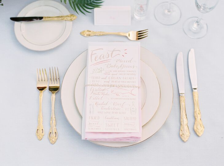 "Each menu stood out with small illustrations and an unstructured design. The pink and gold hues made it even more chic, as they matched the silverware, place settings and ombre napkins. ""Our napkins were unreal,"" Francesca says. ""Danielle, my planner, hand-dyed all of them the perfect coral ombre. I was blown away by her work, and the best part was I got to keep them all."""