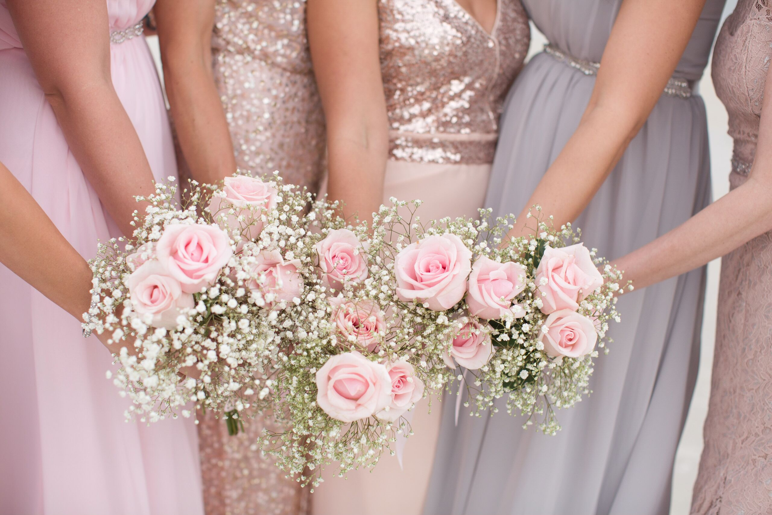 Pink Rose and Baby's Breath Bridesmaid Bouquets