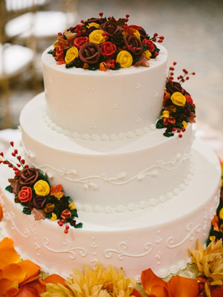 17 gorgeous fall wedding cakes fall wedding cake with red orange and yellow buttercream roses junglespirit Choice Image