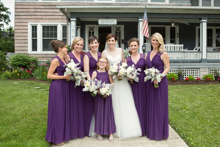 Elena's bridesmaids wore floor-length purple dresses with sheer straps. All the ladies held lush bouquets filled with peonies, hydrangeas and several other blooms, including lavender.