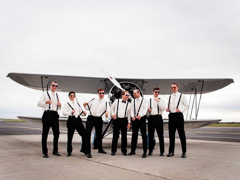 Groomsmen in front of a plane