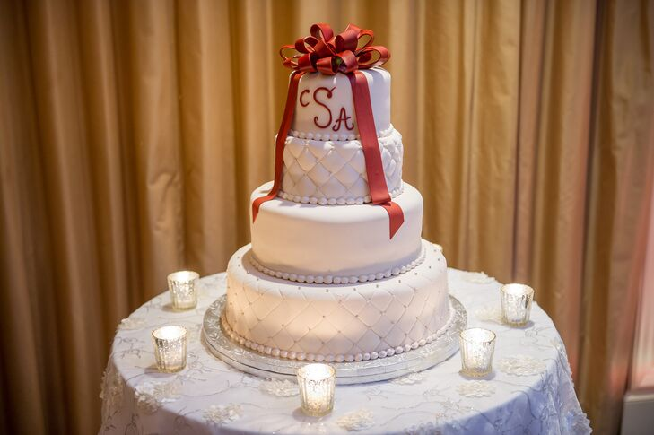 Tiered Wedding Cake With Red Fondant Ribbon