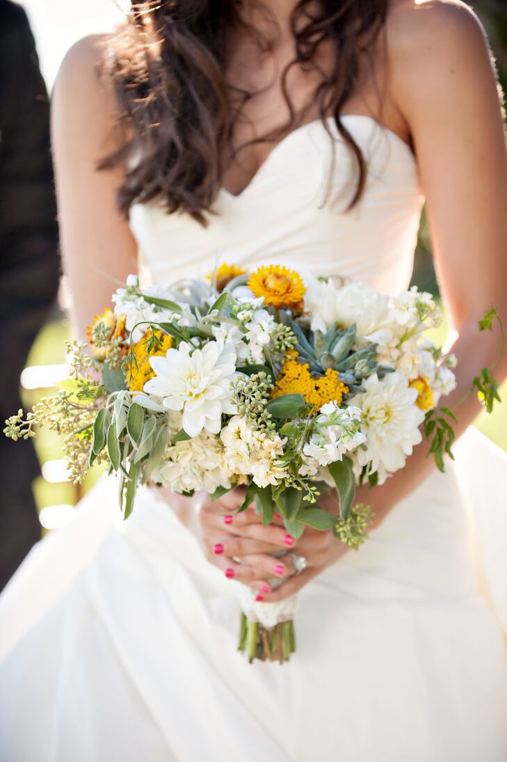 The bride carried a yellow, green and white bouquet. The main flowers were yellow straw flowers, green succulents and white dahlias to create a rustic but modern feel.