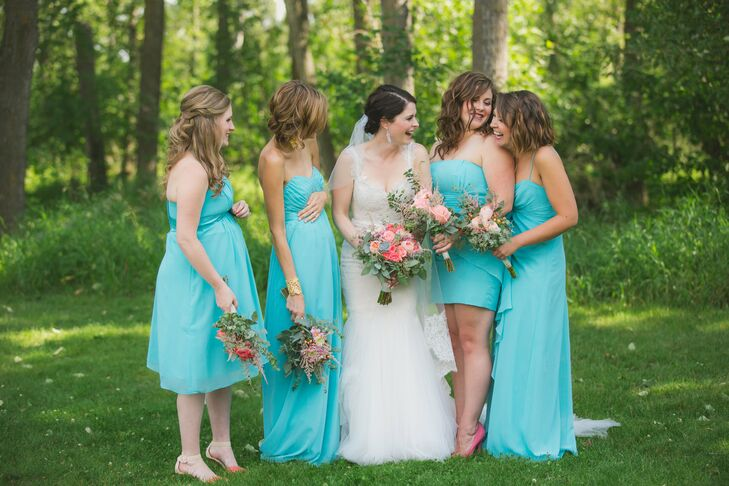 The bridesmaids wore their own style of dress aqua blue. Coral pink shoes completed the look.