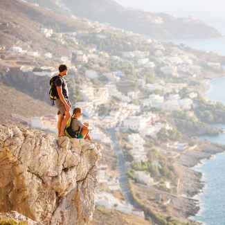 Couple hiking a cliff on honeymoon