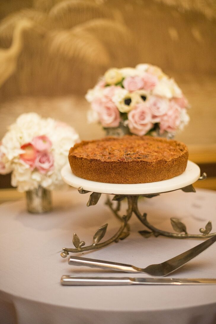 Since the bride didn't really like cake, the couple decided to have wedding pie instead. They cut a chocolate pecan pie, and the guests were served mini versions of chocolate pecan, cherry and key lime.