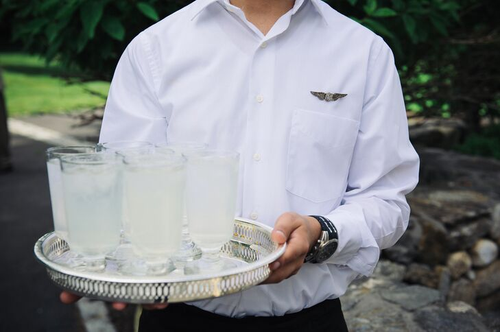 Waiters wearing iconic pilot wing pins on their shirts passed out drinks during cocktail hour.