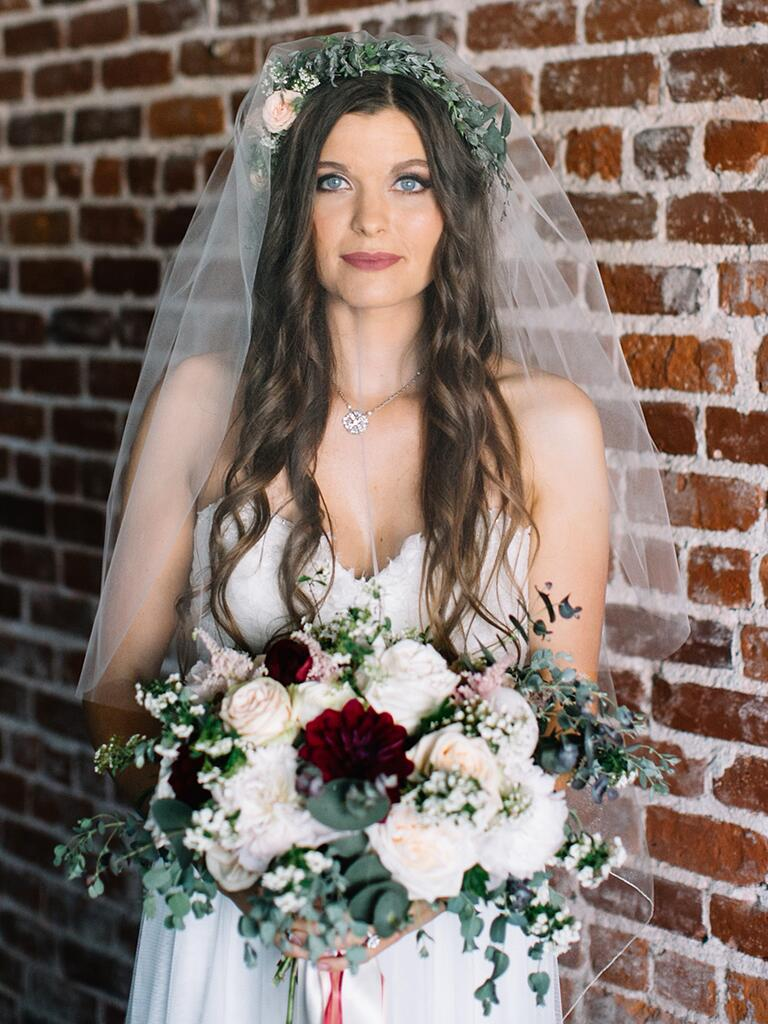 Boho hairstyle and flower crown with a simple veil
