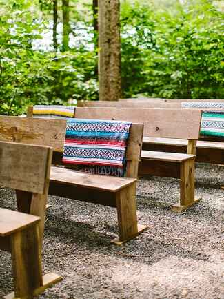 Ceremony seating for a rustic camp wedding
