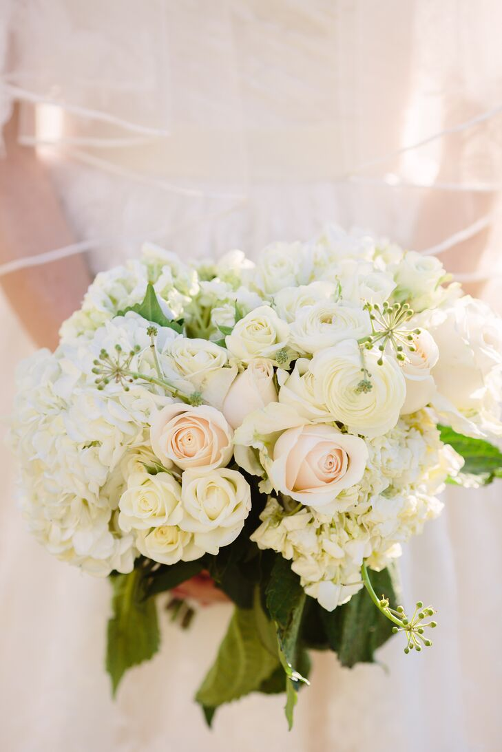Wanting her look to be elegant but natural, Patty carried white roses and hydrangeas in her textured bouquet. Her and her mother's favorite flowers are hydrangeas, so she knew they had to be incorporated. China Rose Florist totally nailed the classic look!