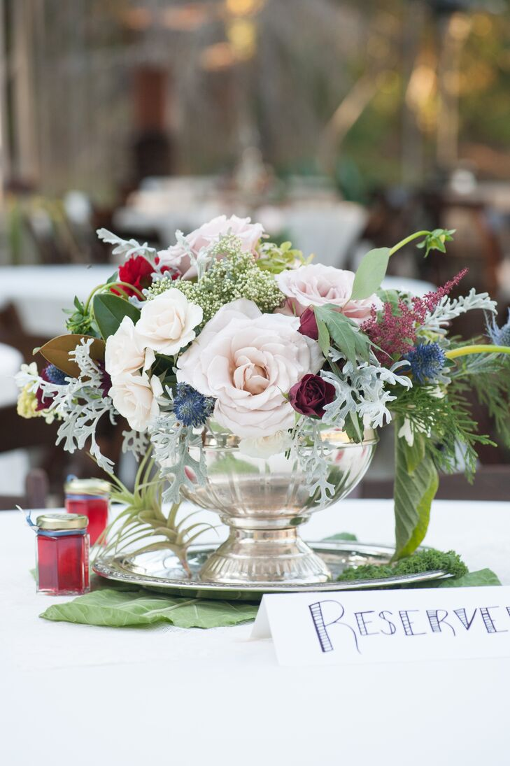 Lush blush and burgundy rose centerpiece