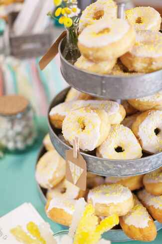 Doughnut tower with white glaze and yellow sprinkles