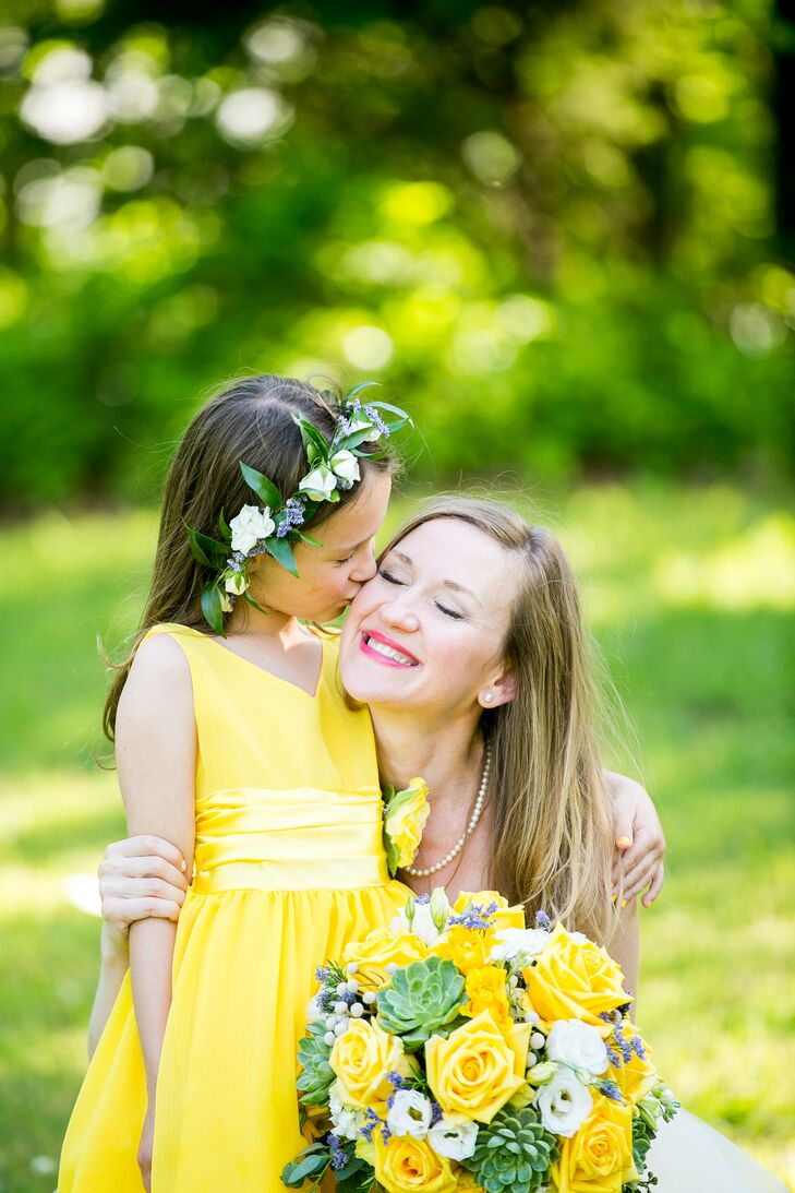 """Our flower girl was Shawn's niece, Cora Rose, whose favorite flower is High and Magic Roses, which she calls 'Cora Roses,' "" Amanda says. ""We made sure to get 'Cora Roses' for her to toss."" She matched the yellow palette with a canary yellow dress."