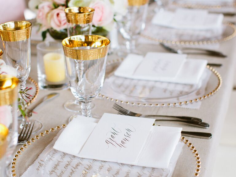 Gold glasses at traditional reception table