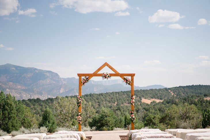 Wooden Wedding Arch with Pink Flower Arrangements