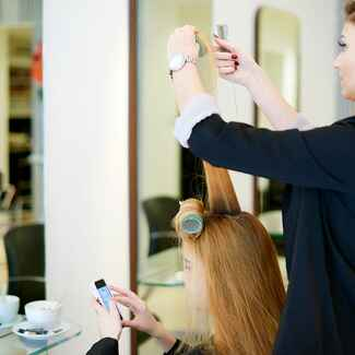 Woman having hair done in a salon
