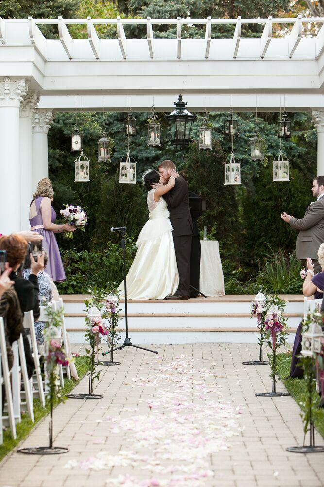 White Wedding Arch with Hanging Lanterns