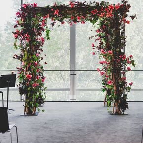 burgundy and pink floral wedding arch