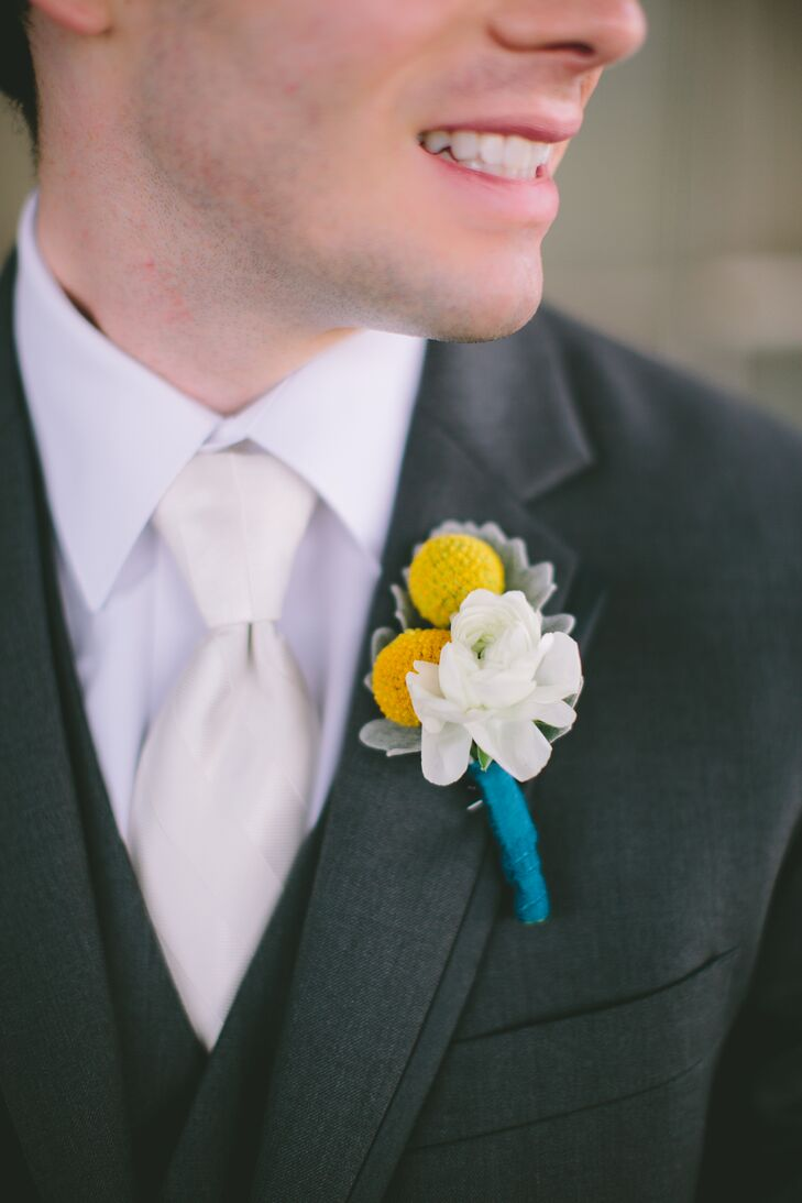 The groom and groomsmen wore white ranunculus, yellow billy balls and lamb's ear for their rustic boutonniere. The stems were tied with teal ribbon to match the yellow and teal color palette. Sayo and Blake loved how the rustic boutonnieres match the modern vintage vibe of the wedding.